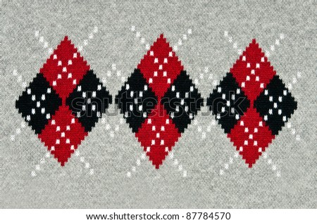 knitted gray background with a pattern. - stock photo