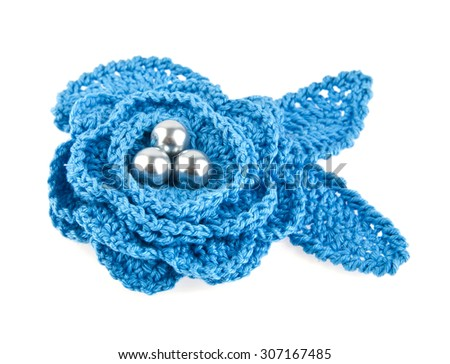 knitted handmade flower isolated on white background