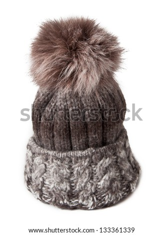 knitted hat with fur bubo - stock photo
