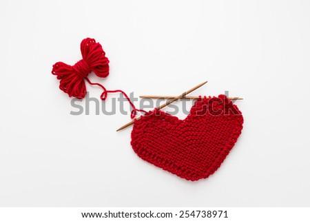 Knitted heart shape pattern - stock photo