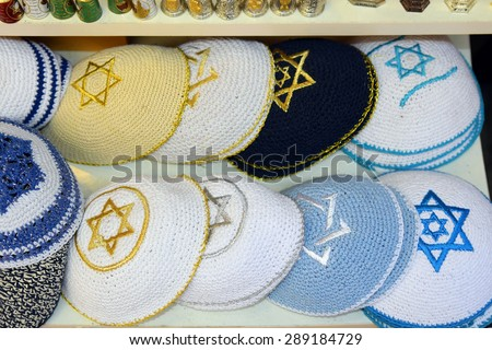 knitted jewish religious caps (yarmulke) on the market in Jerusalem, Israel - stock photo