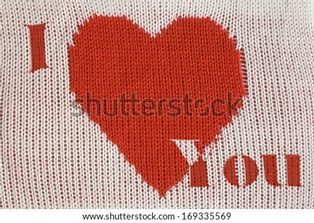"Knitted red heart shape and inscription ""I love You"" on white background"