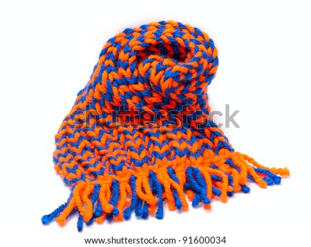 knitted scarf and cap with fringe on white background - stock photo