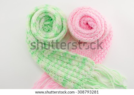 Knitted scarf isolated on white background,pink,green - stock photo