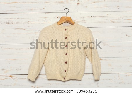 knitted sweater on wooden clothes rack