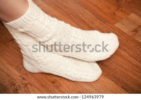 knitted white socks on woman's feet