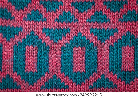 Knitted woolen background, red texture