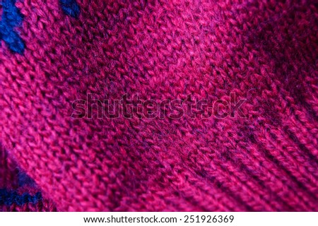 Knitted woolen background, red texture - stock photo