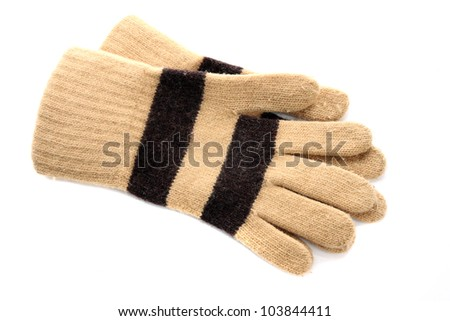 Knitted woolen brown gloves on a white background - stock photo