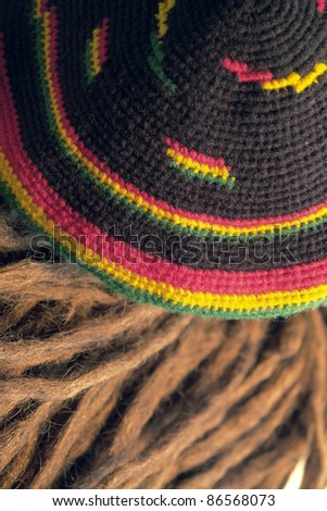 knitted woolen rasta cap and dreadlocks - stock photo