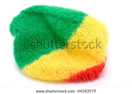 Knitted woollen bonnet / hat in the rasterfairian colours. - stock photo