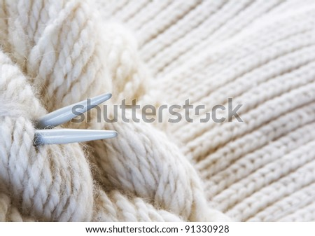 knitting background - yarn, needles