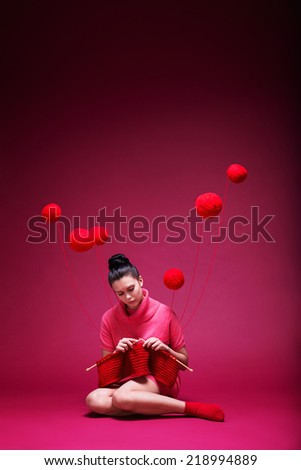 Knitting girl on a red background