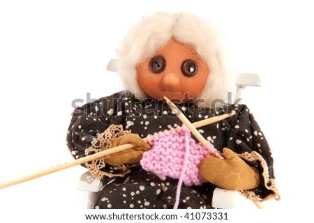 knitting grandma sitting in a rocking chair - stock photo