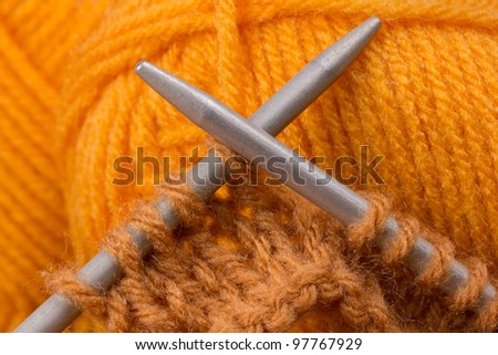 knitting needles and  brown skein of acrylic - stock photo