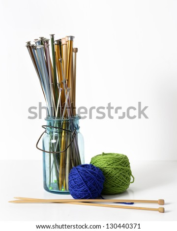 Knitting Needles in a Jar and Colorful Yarn - stock photo