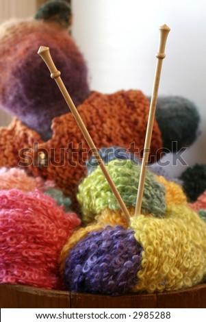 knitting needles in balls of yarn - stock photo