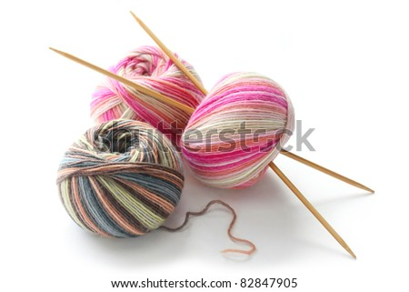 knitting sock yarn balls with noodles on white background - stock photo