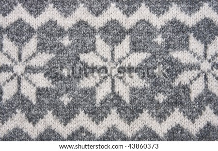Knitting texture with white and grey ornament. - stock photo