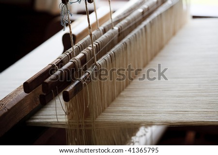 Knitting threads tense on the machine tool, close-up - stock photo
