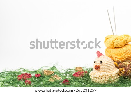 knitting toy chicken on a background of thread - stock photo