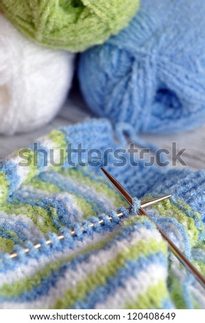 Knitting with colorful yarn - stock photo