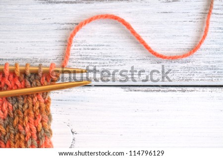 Knitting with yarn in autumn colors - stock photo