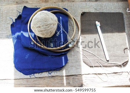 knitting wool and blue cotton on wood table