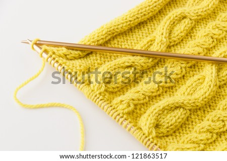 Knitting wool and knitting needles on light background. selective focus