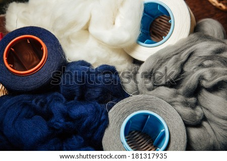 knitting wool, old winder machine, needle hank skein ball clews for knitted work, vintage hand mesh making - stock photo