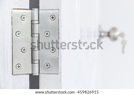 Knob locks with keys on the door - stock photo