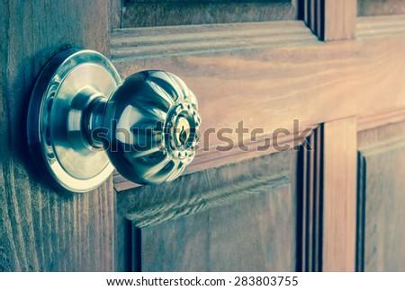 knob on old wooden door,vintage effect filter - stock photo