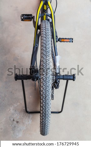 Knobby winter tire with spikes on a mountain bike close-up  - stock photo