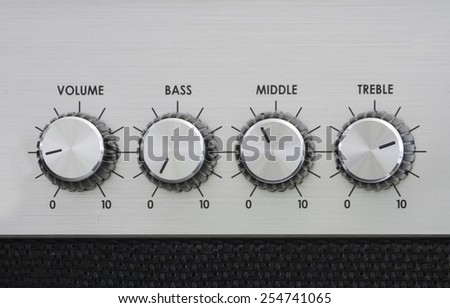 Knobs from the front of an amplifier - stock photo
