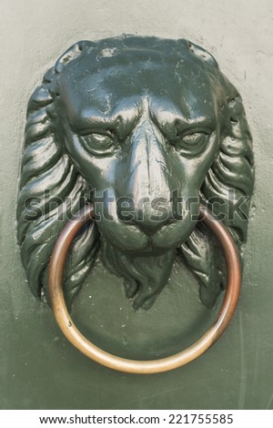 knocker in the shape of a lion, classic lion of Venice Italy