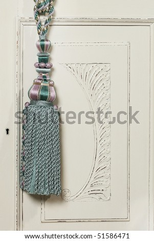 Knot and tassel on classic luxury curtain - stock photo