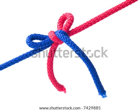 Knot from  red and blue cords isolated on  white.