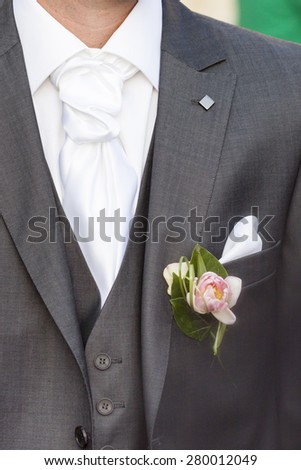 Knot necktie with flower - stock photo