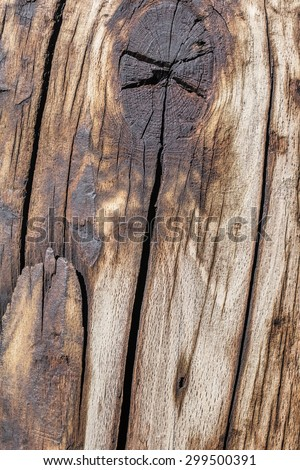 Knotted bituminous surface texture of an old weathered, rotten, cracked Square Timber Bollard, made of obsolete, scrapped Railroad Cross Tie Timber. - stock photo
