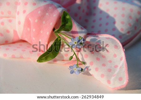 Knotted handkerchief reminder for recall when memory is not reliable any more. Forget-me-not is also the symbol of remembrance.  - stock photo