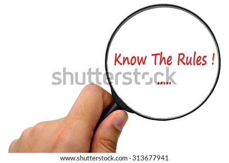 Know The Rules word. Magnifier and puzzles. - stock photo