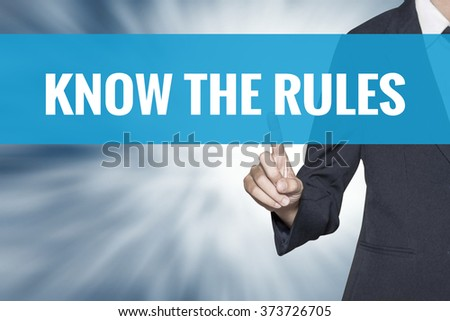 Know the Rules word on virtual screen touch by business woman cyan sky tab - stock photo
