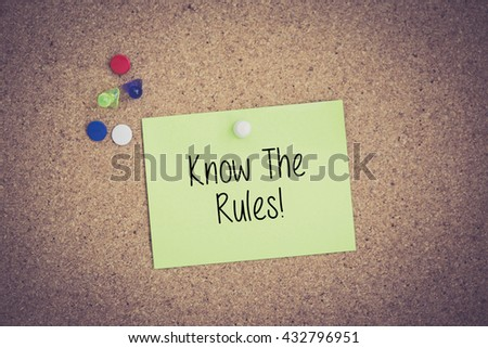 Know The Rules! written on sticky note pinned on pinboard - stock photo
