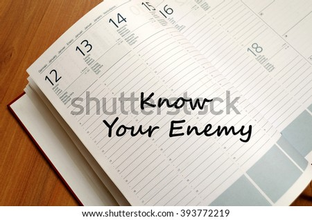 Know your enemy text concept write on notebook  - stock photo