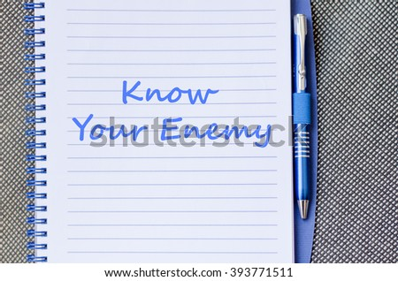 Know your enemy text concept write on notebook with pen - stock photo