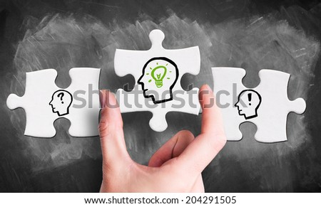 Knowledge creation process with the idea as the missing piece of the puzzle - stock photo