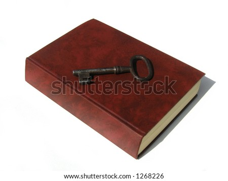Knowledge is the key. Old unnamed generic book with an old key on it. Space for a book title. Clipping path included.