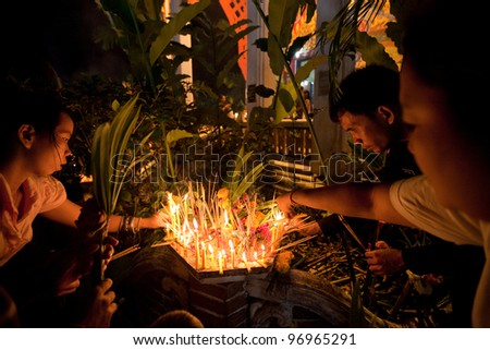 KO CHANG, THAILAND - MARCH 7: People take part in Makha Bucha ceremony in the monastery Wat Klong Prao on March 7, 2012 in Ko Chang, Thailand. It is day of gratitude to the Buddha for his teachings.