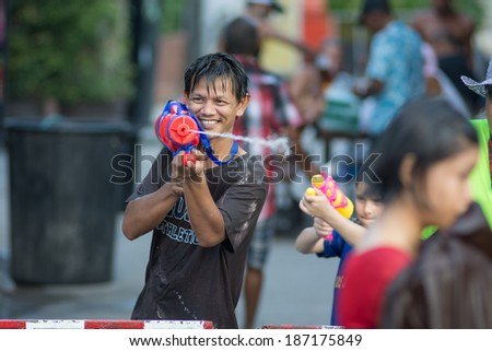 KO SAMUI, THAILAND - APRIL 13: Foreigners and Thai people enjoy splashing water together in songkran festival on April 13, 2014 in Ko Samui island, Thailand.