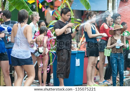 KO SAMUI, THAILAND - APRIL 13: Foreigners  enjoy splashing water together in songkran festival on April 13, 2013 in Ko Samui island, Thailand.
